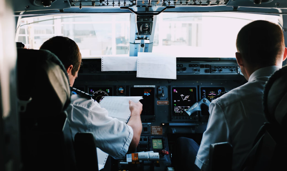 pilots using checklist prior to takeoff.