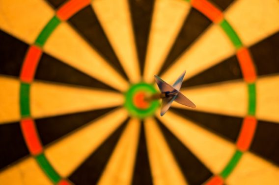 Dart hitting a bullseye.
