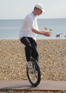 Unicycle juggling.