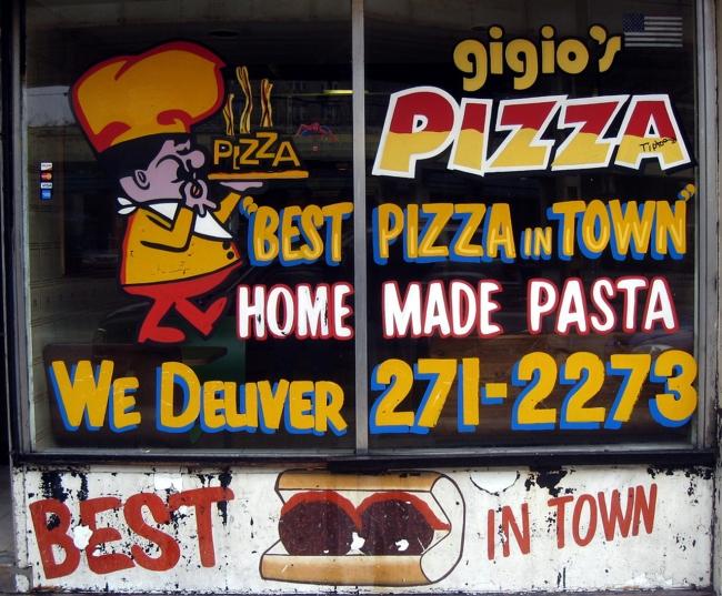 Best pizza in town window.