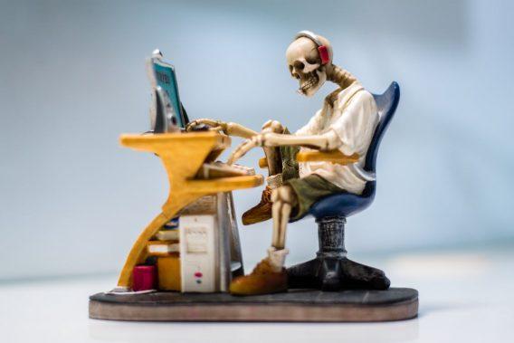 skeleton at desk for customer service.
