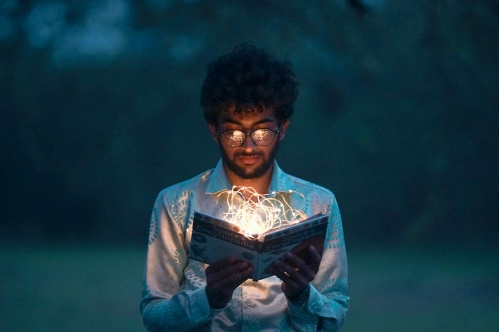 Guy reading a book.