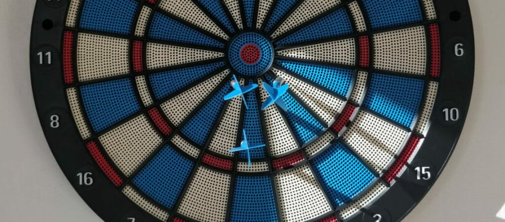 dart board with three darts.